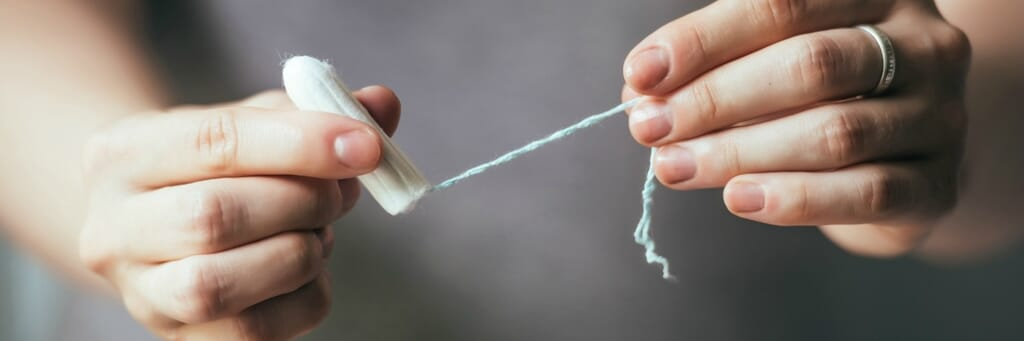 Young woman hands holding hygienic tampon