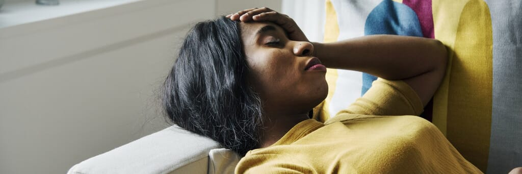 Woman experiencing severe ovulation pain