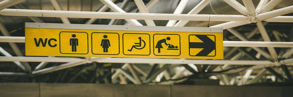 Toilet sign with symbols