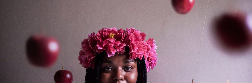 Black Woman with Flower Crown and Apples