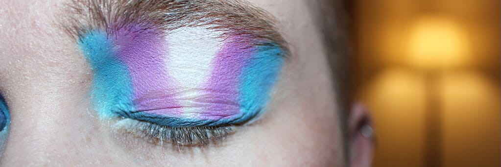 Woman with trans flag eyeshadow